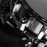 Snare drum in black background, close-up, low lght, black and white